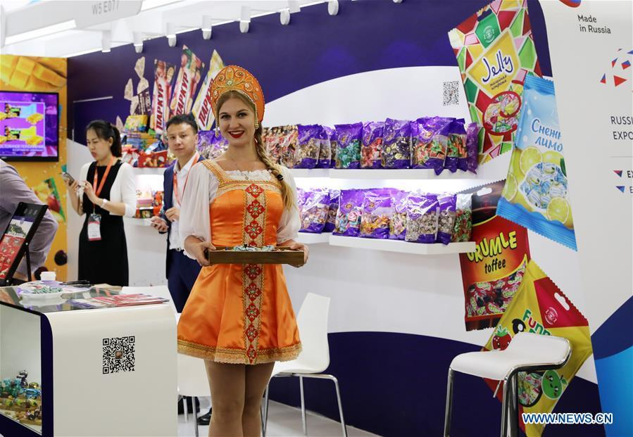 A staff member from a Russian candy exhibitor introduces products during the 20th SIAL China in Shanghai, east China, May 14, 2019. The 20th SIAL China, an international food and beverage exhibition, kicked off at Shanghai New International Expo Center on Tuesday. The exhibition has attracted nearly 4,300 exhibitors from different countries and regions . (Xinhua/Fang Zhe)