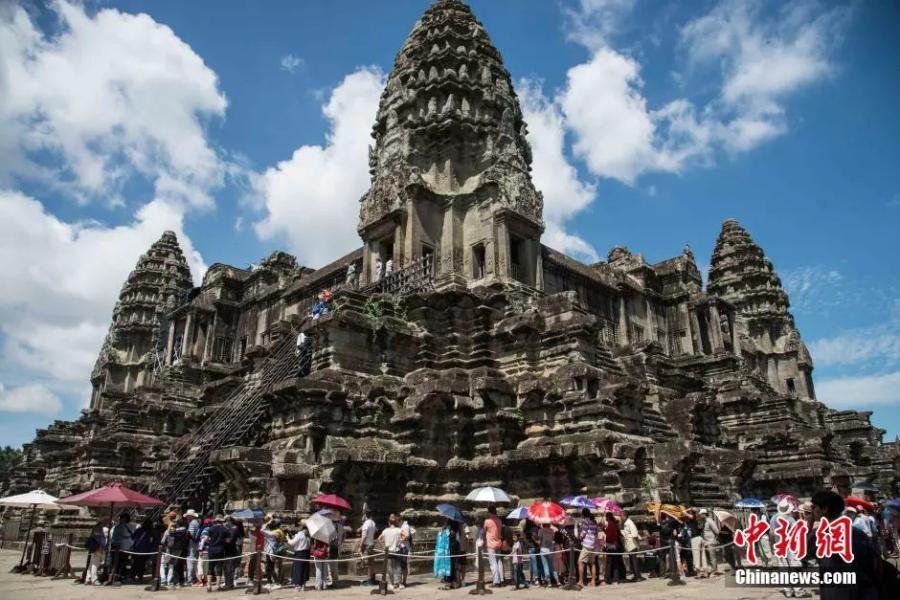 File photo shows the Angkor Wat in Siem Reap, Cambodia. Built between 1113 and 1150 CE, encompassing an area of about 500 acres (200 hectares), Angkor Wat is one of the largest religious monuments ever constructed. Its name means \