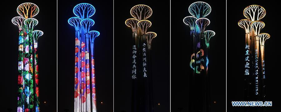 Combo photo taken on May 14, 2019 shows the night view of the Olympic Tower in Beijing, capital of China. Roads and buildings were illuminated Tuesday evening before the upcoming Conference on Dialogue of Asian Civilizations (CDAC) in Beijing. (Xinhua/Ju Huanzong)