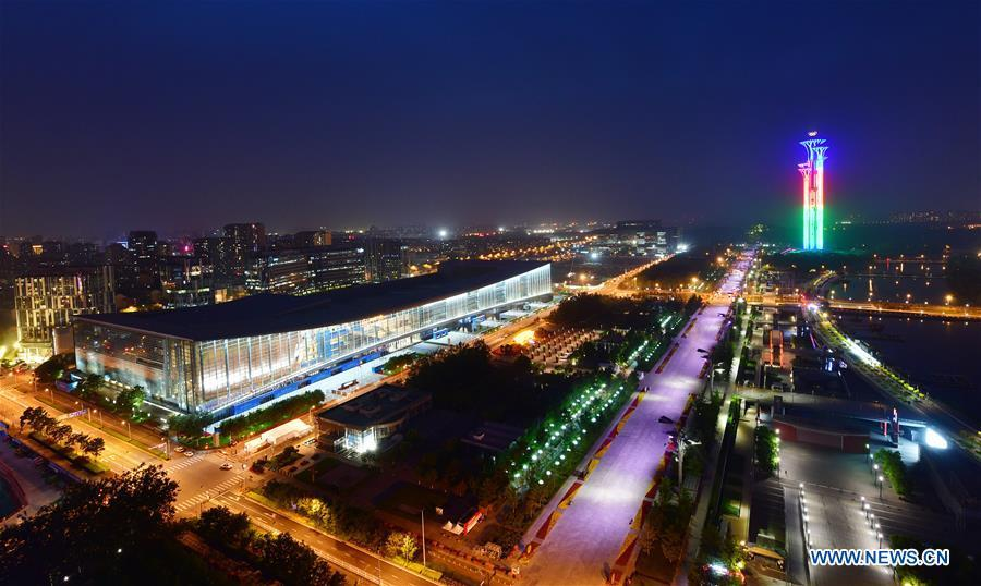 Photo taken on May 14, 2019 shows the night view of the China National Convention Center and the Olympic Tower in Beijing, capital of China. Roads and buildings were illuminated Tuesday evening before the upcoming Conference on Dialogue of Asian Civilizations (CDAC) in Beijing. (Xinhua/Li He)