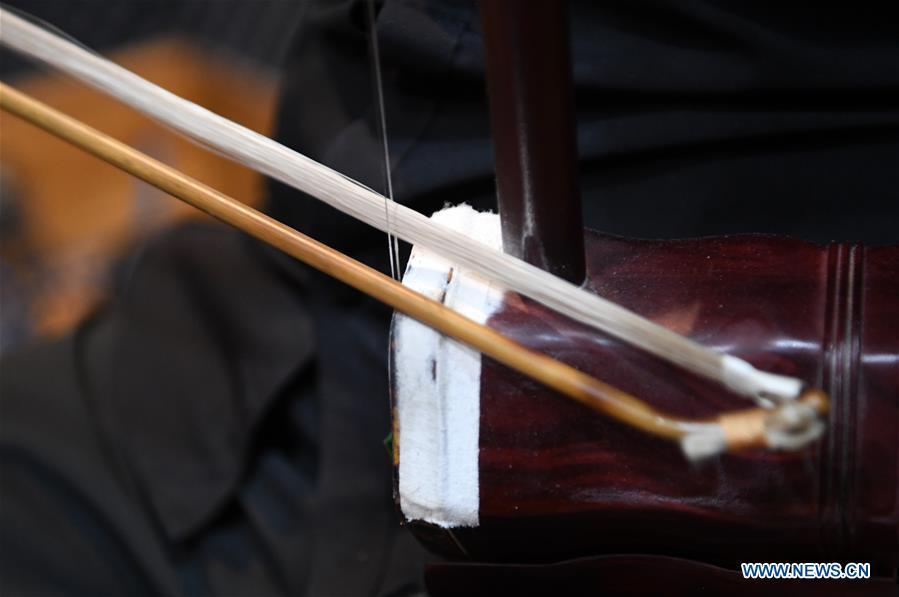 Photo taken on May 13, 2019 shows the bow and the strings of an Erhu in Lanzhou, northwest China\'s Gansu Province. Erhu, sometimes known as the Chinese violin or Chinese two-stringed fiddle, is a Chinese traditional two-stringed bowed musical instrument. It is used as a solo instrument as well as in small ensembles and large orchestras. Erhu, traced back to ancient Chinese Tang dynasty (618-907), is now used in both traditional and contemporary music arrangements, such as in pop, rock and jazz. The famous solo pieces include Er Quan Ying Yue (Two Springs Reflecting the Moon) by Abing and Sai Ma (Horse Race) by Huang Haihuai. (Xinhua/Fan Peishen)