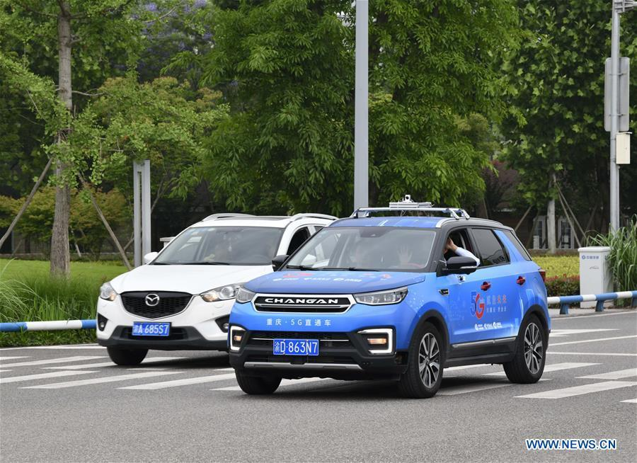 A car (R) is controlled by a remote operator during a test run in Chongqing, southwest China, May 15, 2019. A remote-controlled car powered by the 5G network completed a test run on Wednesday in Chongqing. During the test run, a remote operator was able to control the car while watching the live feed of road conditions supported by the 5G network. (Xinhua/Liu Chan)