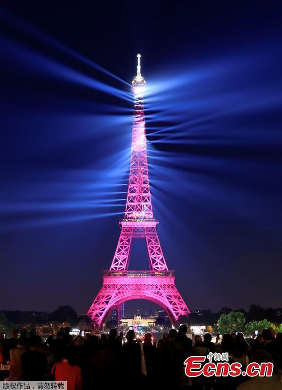 The Eiffel tower is illuminated during a light show to celebrate its 130th anniversary in Paris, France, May, 15, 2019. (Photo/Agencies)