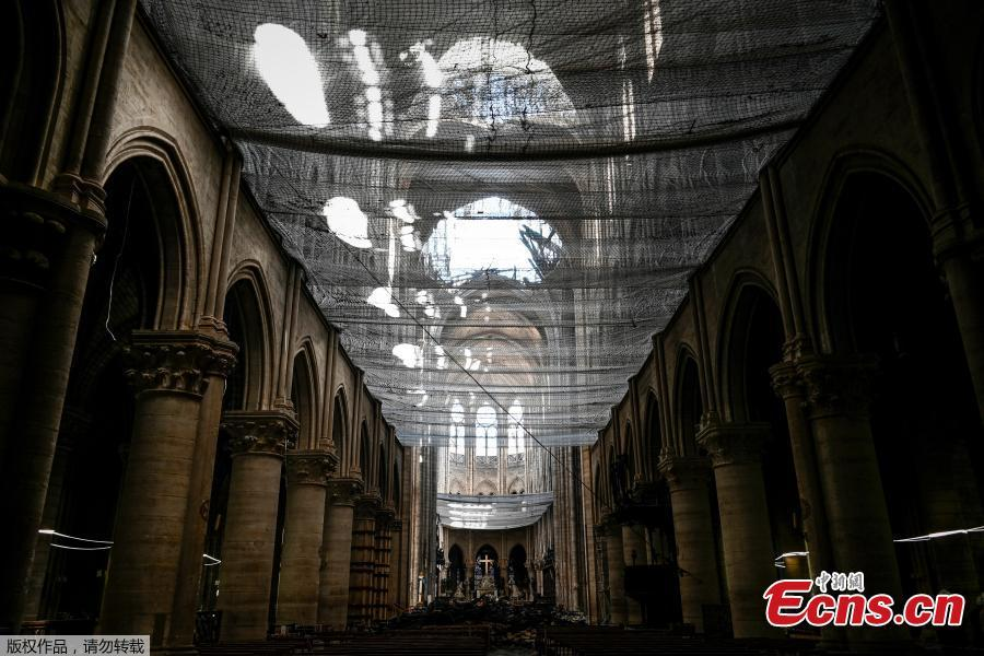 A picture shows a protective net inside the Notre Dame de Paris Cathedral, Wednesday May 15, 2019 in Paris. French Culture Minister Franck Riester says that one month after a fire engulfed Notre Dame Cathedral, the edifice is still being made safe enough for restoration to begin. (Photo/Agencies)