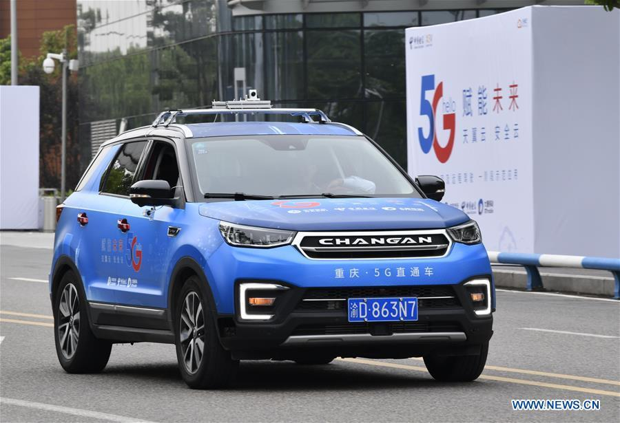 A car is controlled by a remote operator during a test run in Chongqing, southwest China, May 15, 2019. A remote-controlled car powered by the 5G network completed a test run on Wednesday in Chongqing. During the test run, a remote operator was able to control the car while watching the live feed of road conditions supported by the 5G network. (Xinhua/Liu Chan)