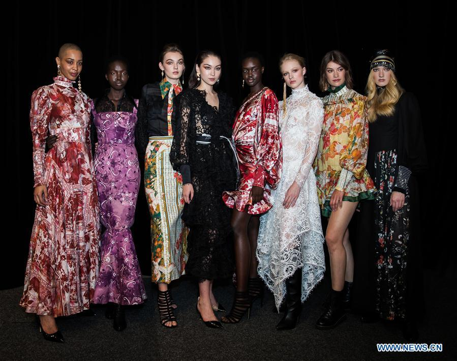 Models pose for a photograph backstage ahead of the Leo & Lin show during Fashion Week Australia in Sydney, Australia, May 15, 2019. (Xinhua/Zhu Hongye)