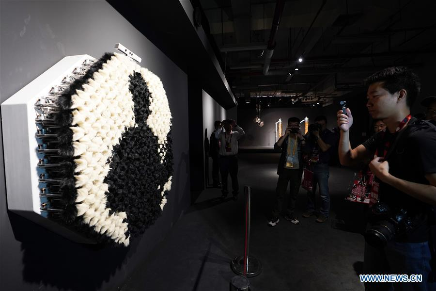 Visitors view an art work during the Asian Digital Art Exhibition held in Beijing, capital of China, May 16, 2019. The exhibition, part of the cultural activities of the Conference on Dialogue of Asian Civilizations, kicked off on Thursday. Works of 30 artists from 12 countries and regions are on show during the exhibition. (Xinhua/Ju Huanzong)