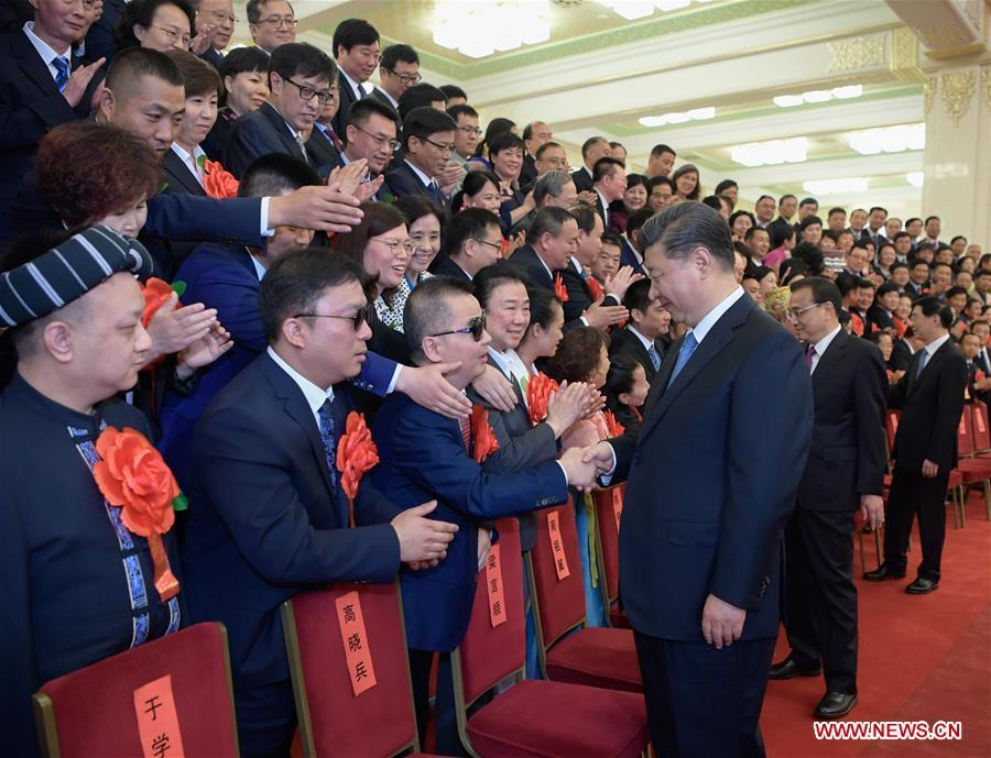 Chinese President Xi Jinping, also general secretary of the Communist Party of China (CPC) Central Committee and chairman of the Central Military Commission, meets with representatives attending a ceremony commending role models with disabilities and people who have made outstanding contributions in helping the disabled, at the Great Hall of the People in Beijing, capital of China, May 16, 2019. Premier Li Keqiang and Wang Huning, a member of the Secretariat of the CPC Central Committee, both members of the Standing Committee of the Political Bureau of the CPC Central Committee, also met with the representatives. (Xinhua/Li Xueren)