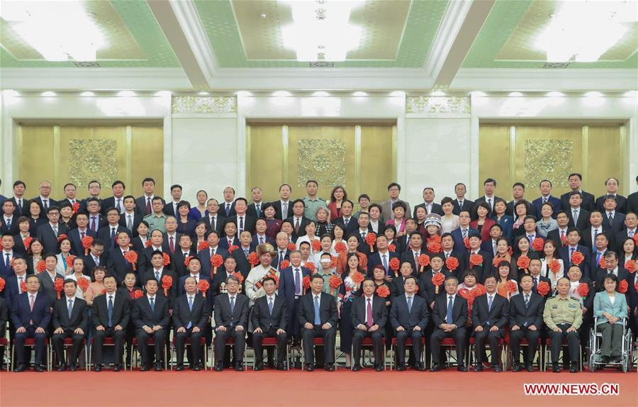 Chinese President Xi Jinping, also general secretary of the Communist Party of China (CPC) Central Committee and chairman of the Central Military Commission, meets with representatives attending a ceremony commending role models with disabilities and people who have made outstanding contributions in helping the disabled, at the Great Hall of the People in Beijing, capital of China, May 16, 2019. Premier Li Keqiang and Wang Huning, a member of the Secretariat of the CPC Central Committee, both members of the Standing Committee of the Political Bureau of the CPC Central Committee, also met with the representatives. (Xinhua/Ding Lin)