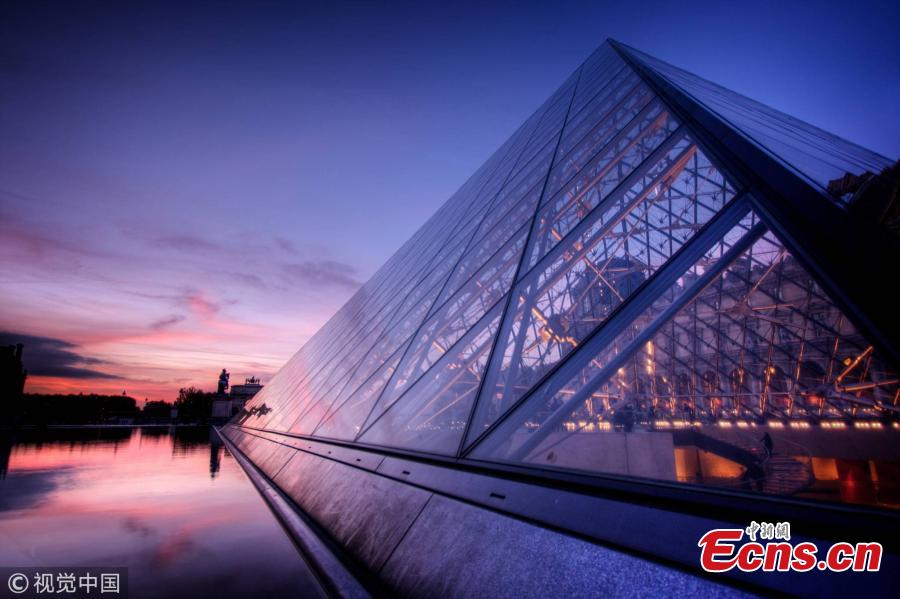 View of the glass pyramid, designed by Chinese-born U.S. Architect I.M. Pei, which is the entrance of the Louvre Museum in Paris. World-renowned architect Ieoh Ming Pei, commonly known as I.M. Pei, has died at age 102. Pei was born in Guangzhou, China, and raised in Hong Kong and Shanghai, before moving to the United States in 1935. He won a wide variety of prizes and awards in the field of architecture. (Photo/VCG)