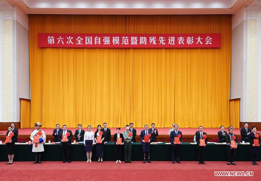 Chinese State Councilor Wang Yong attends a ceremony commending role models with disabilities and people who have made outstanding contributions in helping the disabled in Beijing, capital of China, May 16, 2019. (Xinhua/Wang Ye)