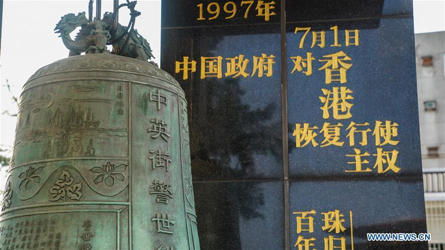 Photo taken on May 18, 2019 shows the warning bell in front of the Chung Ying Street Historical Museum in Yantian District of Shenzhen, south China\'s Guangdong Province. The Chung Ying Street (Chung Ying means China and Britain), linking Shenzhen of Guangdong Province and Hong Kong in south China, has once again set sail in the development of the Guangdong-Hong Kong-Macao Greater Bay Area and embarked on a new journey towards high-quality development. (Xinhua/Liu Jie)