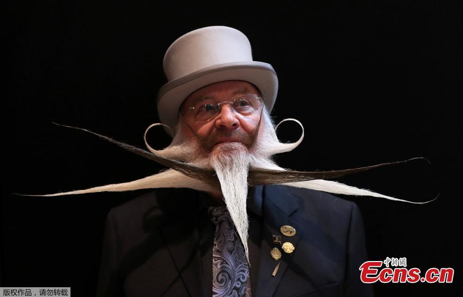 A participant of the international World Beard and Moustache Championships poses before taking part in one of the 17 categories of beard and moustache styles competing in Antwerp, Belgium May 18, 2019.(Photo/Agencies)