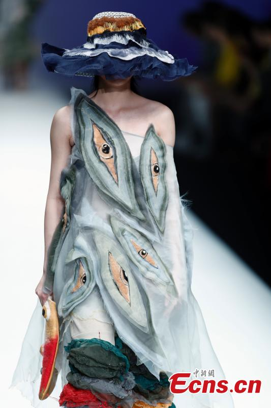 A model wears a creation by a newcomer designer during the China Graduate Fashion Week in Beijing, May 19, 2019. The seven-day event concluded on Sunday night, with the announcement of ten winning newcomer designers. (Photo: China News Service/Sheng Jiapeng)