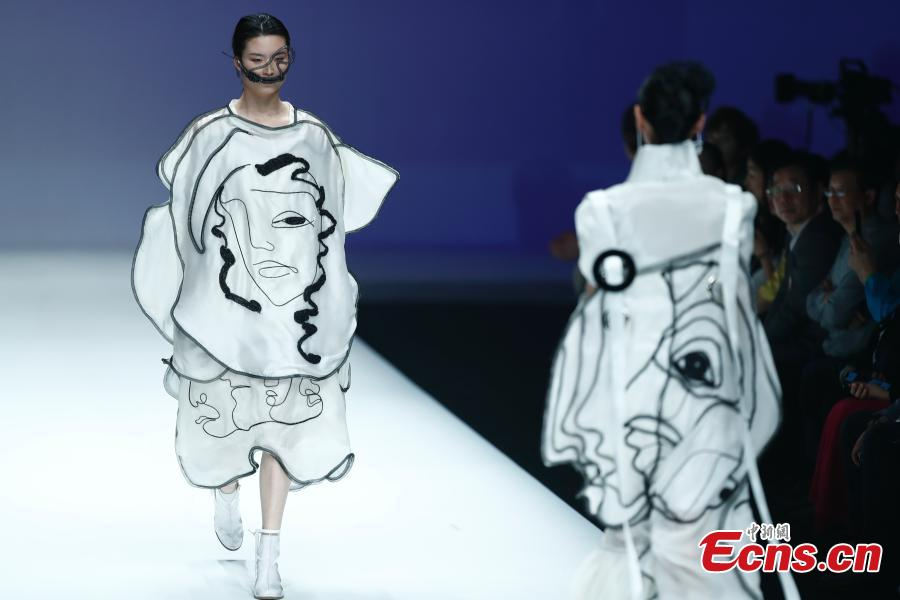Models wear creations by a newcomer designer during the China Graduate Fashion Week in Beijing, May 19, 2019. The seven-day event concluded on Sunday night, with the announcement of ten winning newcomer designers. (Photo: China News Service/Sheng Jiapeng)