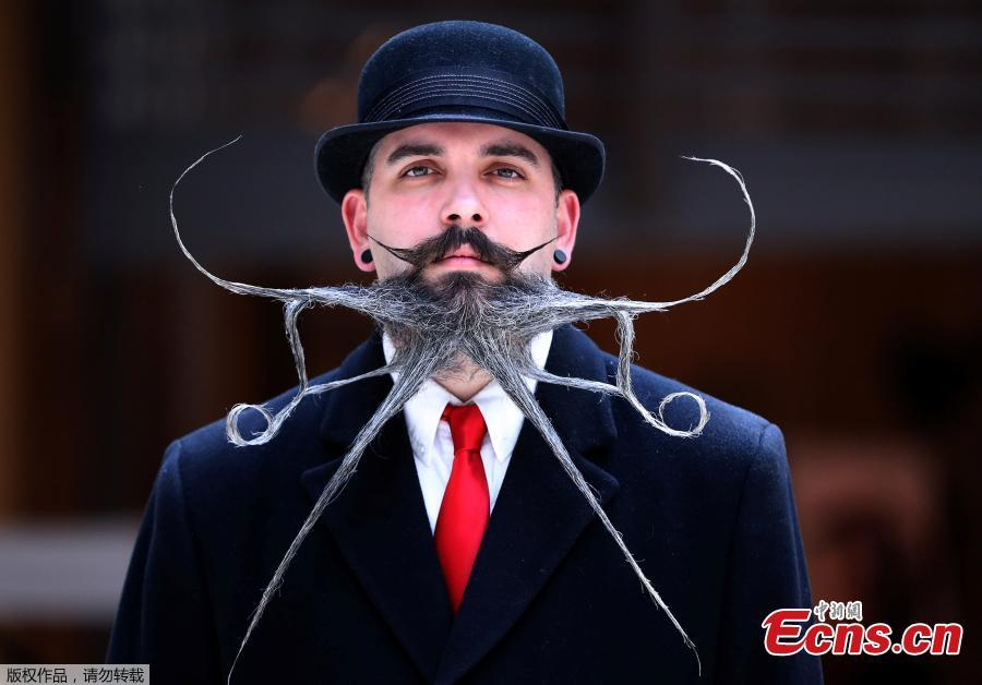 A participant of the international World Beard and Moustache Championships poses before taking part in one of the 17 categories of beard and moustache styles competing in Antwerp, Belgium May 18, 2019. (Photo/Agencies)
