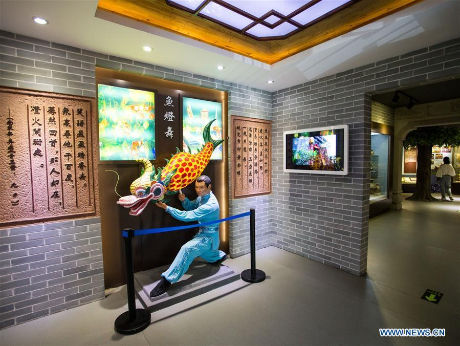 A visitor views exhibits at a museum themed Shatoujiao fish lantern dance in Yantian District of Shenzhen, south China\'s Guangdong Province, May 18, 2019. The Chung Ying Street (Chung Ying means China and Britain), linking Shenzhen of Guangdong Province and Hong Kong in south China, has once again set sail in the development of the Guangdong-Hong Kong-Macao Greater Bay Area and embarked on a new journey towards high-quality development. (Xinhua/Meng Chenguang)