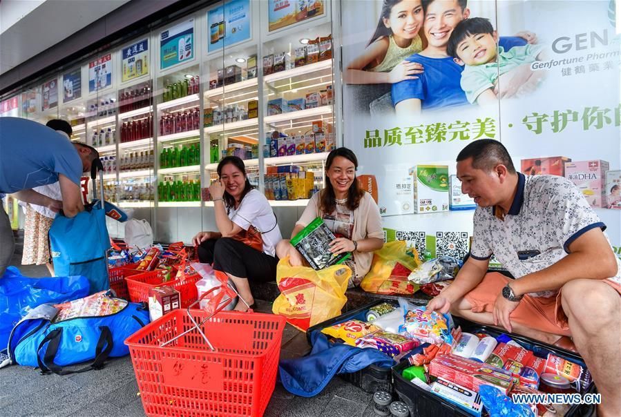 Customers arrange purchases in the Chung Ying Street, May 18, 2019. The Chung Ying Street (Chung Ying means China and Britain), linking Shenzhen of Guangdong Province and Hong Kong in south China, has once again set sail in the development of the Guangdong-Hong Kong-Macao Greater Bay Area and embarked on a new journey towards high-quality development. (Xinhua/Liu Dawei)