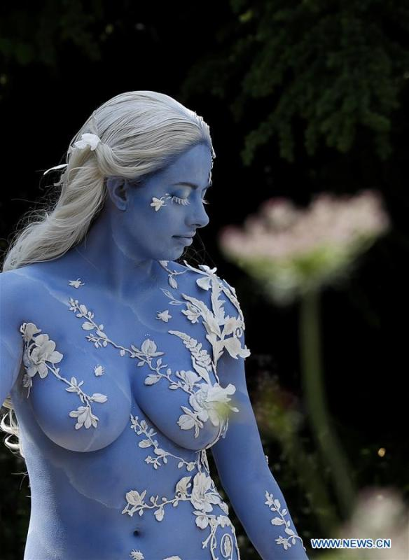A model poses for a photo on the Wedgwood Garden at the RHS (Royal Horticultural Society) Chelsea Flower Show press day in London, Britain on May 20, 2019. The annual RHS Chelsea Flower Show will open to the public here from May 21 to 25. (Xinhua/Han Yan)