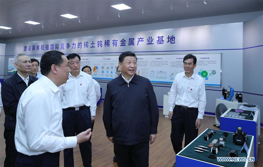 Chinese President Xi Jinping, also general secretary of the Communist Party of China Central Committee and chairman of the Central Military Commission, learns about the production process and operation of the JL MAG Rare-Earth Co. Ltd. as well as the development of the rare earth industry in the city of Ganzhou in east China\'s Jiangxi Province on May 20, 2019. Xi Jinping visited Jiangxi Province Monday on an inspection tour. (Xinhua/Ju Peng)