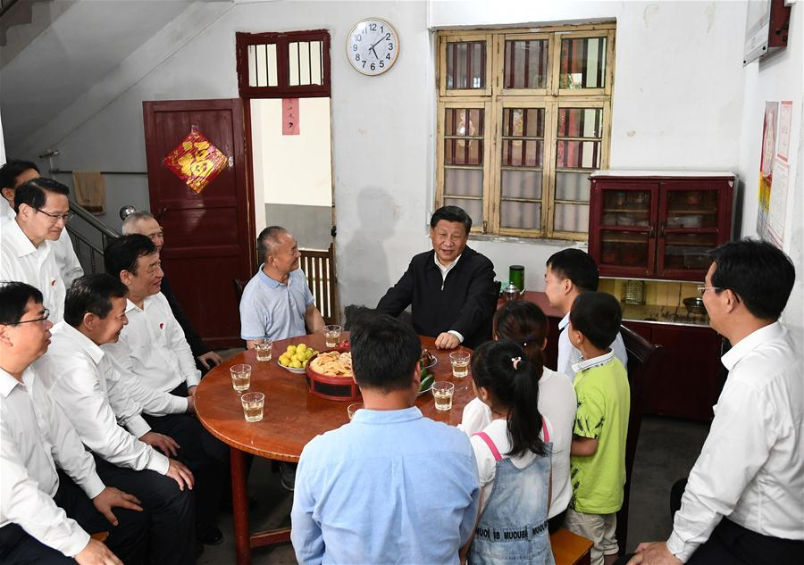 Chinese President Xi Jinping, also general secretary of the Communist Party of China Central Committee and chairman of the Central Military Commission, visits Tantou Village in Yudu County, Ganzhou City, during an inspection tour of east China\'s Jiangxi Province on May 20, 2019. At the home of veteran Sun Guanfa, a descendant of a Red Army martyr, Xi chatted with Sun\'s family and local officials, and learned in detail about the production developments and life improvements of people in the old revolutionary base. (Xinhua/Xie Huanchi)
