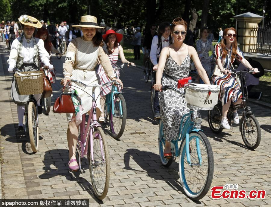 Participants with their bikes wearing vintage clothes attend Retro Cruise 2019, a retro parade on bicycles, similar of the known Tweed Run bike ride, in center of Kiev, Ukraine, on 19 May 2019.(Photo/Sipaphoto)