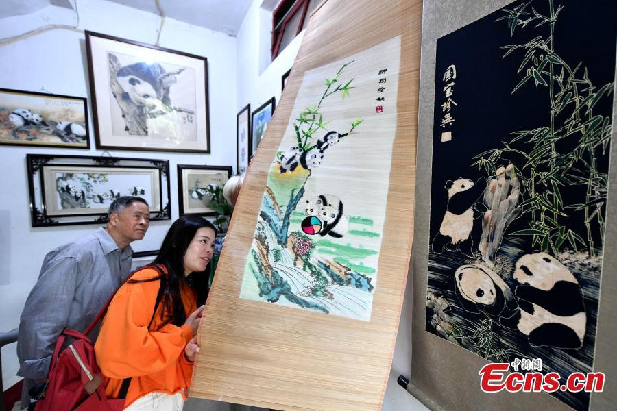 Collector Li Zhiqi shows his collection of giant panda-themed items in Fuzhou City, Fujian Province, May 21, 2019. Li has amassed a trove of nearly 10,000 items featuring the iconic bear, including stamps, dolls, bookmarks, and mugs. (Photo: China News Service/Lyu Ming)