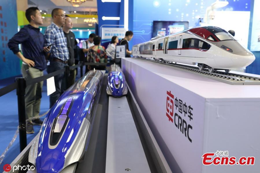 Models of a high-speed maglev train (bottom) and a Fuxing freight bullet train (top) are on display at National Science and Technology Week in the Military Museum of the Chinese People\'s Revolution in Beijing on May 21, 2019.(Photo/IC)