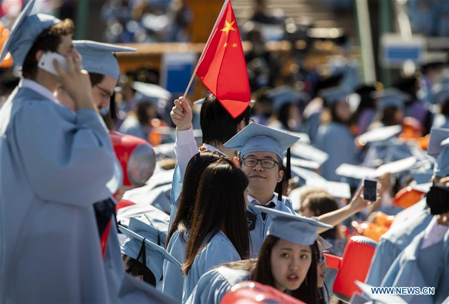 Graduate students from China attend the Columbia University Commencement ceremony in New York, the United States, May 22, 2019. The Columbia University Commencement ceremony of the 265th academic year took place on Wednesday. More than 17,000 students from Columbia\'s 18 schools and affiliates graduated this year. (Xinhua/Wang Ying)