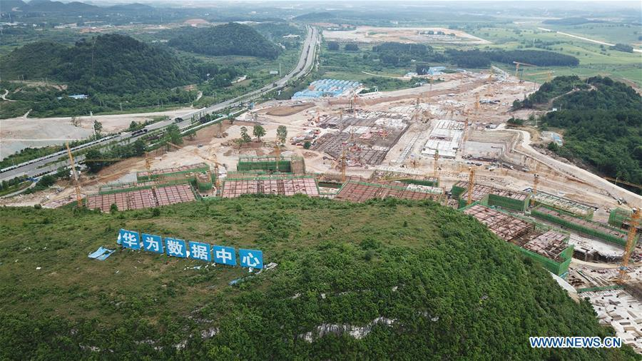 Aerial photo taken on May 19, 2019 shows the construction site of a Huawei Cloud data center in Gui\'an New Area of southwest China\'s Guizhou Province. In Guizhou Province, which hosts China\'s first state-level big data pilot zone, the integration of big data with sectors such as real economy, social management, civil service and rural revitalization has brought significant changes to people\'s life. According to statistics, Guizhou has more than 9,500 big data enterprises and many of them are active players on the global business stage. A 2019 whitepaper published by the China Academy of Information and Communications Technology indicates that Guizhou is taking advantage of big data in the course of its development, as both the growth of the province\'s digital economy and the growth of its employment in digital economy have ranked first in China. (Xinhua/Ou Dongqu)