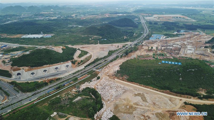 Aerial photo taken on May 19, 2019 shows the Tencent Guian Qixing Center (L) and the construction site of a Huawei Cloud data center in Gui\'an New Area of southwest China\'s Guizhou Province. In Guizhou Province, which hosts China\'s first state-level big data pilot zone, the integration of big data with sectors such as real economy, social management, civil service and rural revitalization has brought significant changes to people\'s life. According to statistics, Guizhou has more than 9,500 big data enterprises and many of them are active players on the global business stage. A 2019 whitepaper published by the China Academy of Information and Communications Technology indicates that Guizhou is taking advantage of big data in the course of its development, as both the growth of the province\'s digital economy and the growth of its employment in digital economy have ranked first in China. (Xinhua/Ou Dongqu)