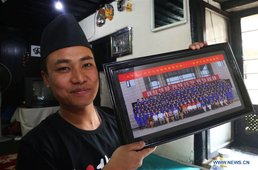 Binaya Hada shows his graduation photo of Beijing Language and Culture University at his home in Bhaktapur, Nepal on May 15, 2019. Binaya Hada is a 34-year-old Nepali young man, whose work was selected for a photographic exhibition on Asian civilization. Graduated from Beijing Language and Culture University of China, Binaya is now dedicated to learning Chinese culture and popularizing knowledge of Chinese language to local population. (Xinhua/Sunil Sharma)