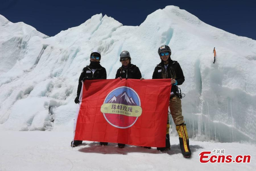 "Three Chinese women pose on top of Mount Qomolangma, known as Mount Everest in the West, on May 22, 2019. With the name of  ""Everest Rose"" , the team is made up of three female mountaineers from Xinjiang Uygur Autonomous Region, Hong Kong Special Administrative Region, and Henan Province. The trio began preparing for the climb on April 8, finally reaching the peak on Wednesday.(Photo/China News Service)"