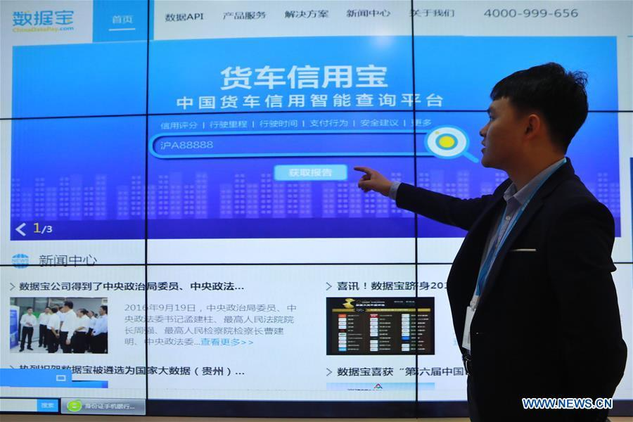 A network technology company staff member shows a truck credit inquiry platform in southwest China\'s Guizhou Province, May 20, 2019. In Guizhou Province, which hosts China\'s first state-level big data pilot zone, the integration of big data with sectors such as real economy, social management, civil service and rural revitalization has brought significant changes to people\'s life. According to statistics, Guizhou has more than 9,500 big data enterprises and many of them are active players on the global business stage. A 2019 whitepaper published by the China Academy of Information and Communications Technology indicates that Guizhou is taking advantage of big data in the course of its development, as both the growth of the province\'s digital economy and the growth of its employment in digital economy have ranked first in China. (Xinhua/Ou Dongqu)