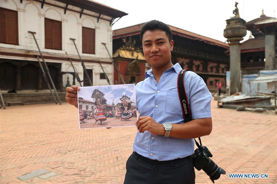 Binaya Hada shows his photographic work \