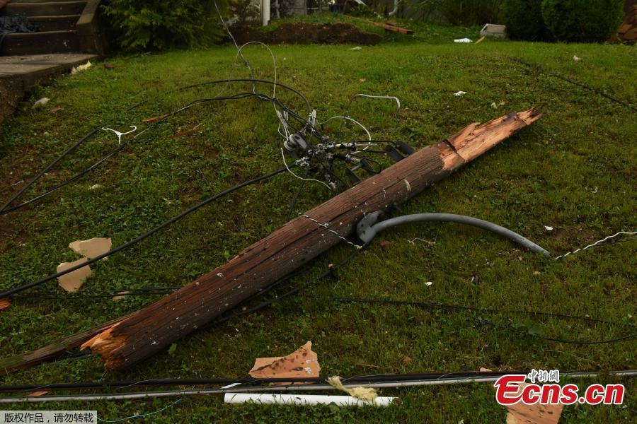 A snapped telephone pole lies on he ground on Union Street following a tornado touchdown overnight in Jefferson City, Missouri, U.S. May 23, 2019. (Photo/Agencies)