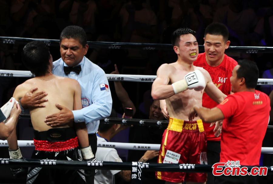 Chinese boxer Xu Can succeeded in defending his World Boxing Association (WBA) featherweight title after defeating challenger Shun Kubo of Japan by technical knockout (TKO) at Xu\'s hometown here on Sunday. The 25-year-old Xu Can took control of the game at the very beginning with steady moves and sharp strikes. In the fifth round, Shun Kubo was knocked down. With cheering audience, Xu Can claimed the victory by TKO in the sixth round.Xu became China\'s youngest world professional boxing champion this January, winning with scores of 117-111, 116-112 and 118-110 over Rojas. After that he was awarded as the first Chinese \