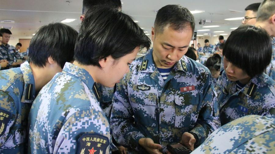 Cadets take their questions to a teacher on board. (Photo provided to chinadaily.com.cn)