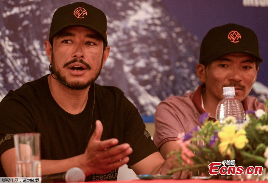 Mountaineer Nirmal Purja (L) speaks and Nepali mountaineer Mingma David Sherpa (R) looks on during a press conference in Kathmandu on May 28, 2019. Nirmal Purja has scaled six mountains peaks above 8 000 meters, including Mount Everest, over the last month as he attempts to summit the world\'s fourteen 8 000-meter peaks. (Photo/Agencies)