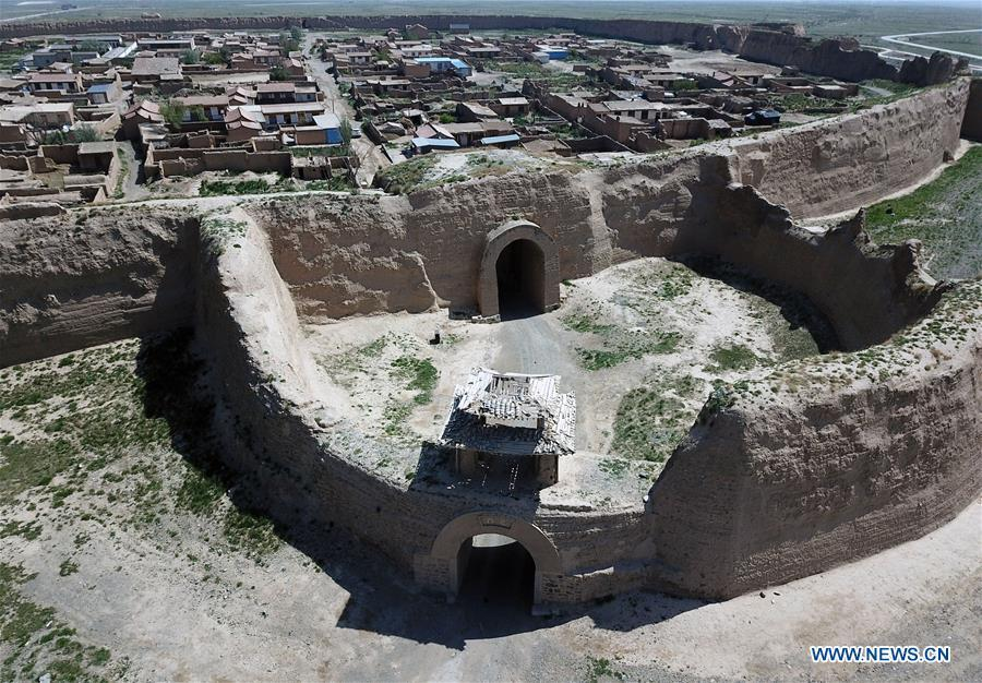 Aerial photo taken on May 28, 2019 shows the southern gate and barbican of the Yongtai ancient city in Jingtai County of Baiyin, northwest China\'s Gansu Province. Construction of the Yongtai ancient city began in the early 17th century and the complex used to be a military fortress. Girdled by 12-meter wall structures totaling 1.7 kilometers in length, the Yongtai ancient city looks like a turtle when seen from above and is thus dubbed \