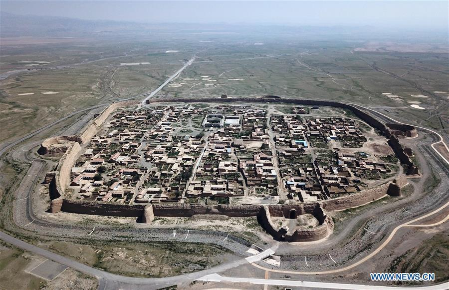 Aerial photo taken on May 28, 2019 shows a view of the Yongtai ancient city in Jingtai County of Baiyin, northwest China\'s Gansu Province. Construction of the Yongtai ancient city began in the early 17th century and the complex used to be a military fortress. Girdled by 12-meter wall structures totaling 1.7 kilometers in length, the Yongtai ancient city looks like a turtle when seen from above and is thus dubbed \
