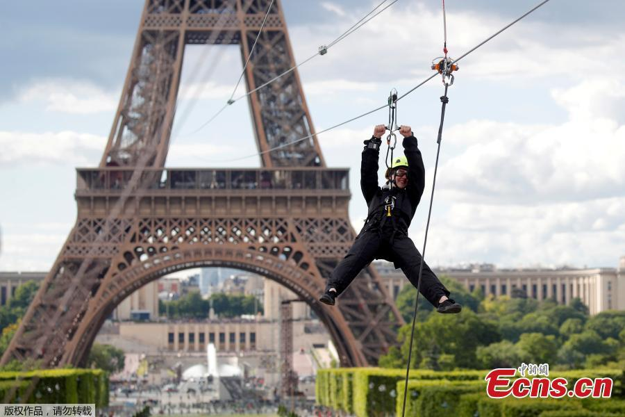 A participant rides a zip line from the second floor of the Eiffel Tower, 115 metres above the ground along an 800-metre long route, as part of the Smash Perrier free event operating until June 2 in Paris, France, May 28, 2019.(Photo/Agencies)