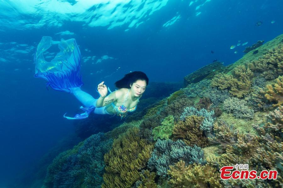 A photograph of a model posing like a mermaid underwater at the Wuzhizhou Island scenic spot captured by photographer Wang Baomin during a four-day photo contest in Sanya City, Hainan Province. (Photo/China News Service)