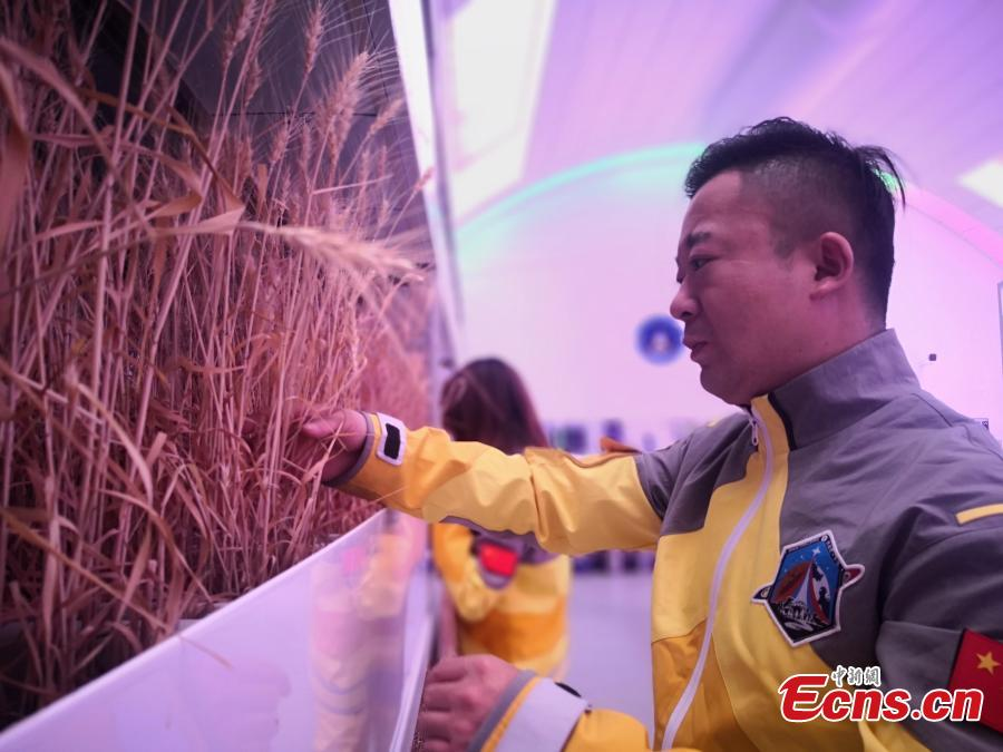 Visitors inside a Mars simulation base in the barren, windswept hills of Jinchang City, Northwest China's Gansu Province, May 29, 2019. Planned to cover 67 square kilometers, Mars Base 1 Camp will include nine modules including a greenhouse and a mock decompression chamber. Authorities hope the camp will boost tourism and allow visitors to feel as though they are on the Red Planet.  (Photo: China News Service/Wei Jianjun)