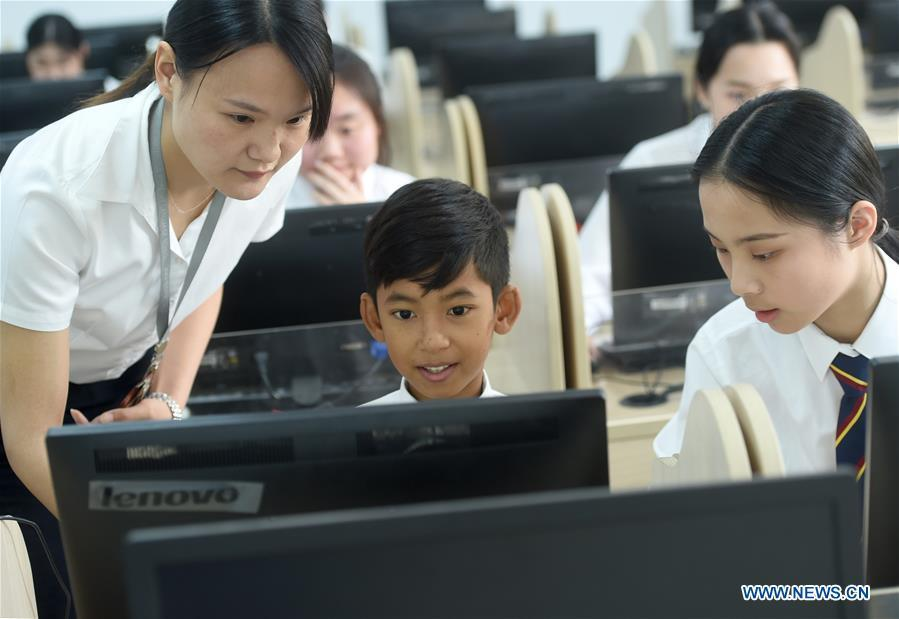 Thuch Salik attends a computer class at a foreign language school in Zhuji, east China\'s Zhejiang Province, May 29, 2019. Thuch Salik became viral overnight when a video clip showing him selling souvenirs in a dozen distinct languages near Angkor Wat was shared online on November 2018. Born in a family with financial difficulties, the 14-year-old Cambodian boy got global attention for his multilingual talent. In May, Salik was offered a place at a foreign language school in Zhuji of east China\'s Zhejiang Province on an education programme funded by a private sponsor in China. Salik said he has high expectations for his education opportunity and life in China. (Xinhua/Han Chuanhao)