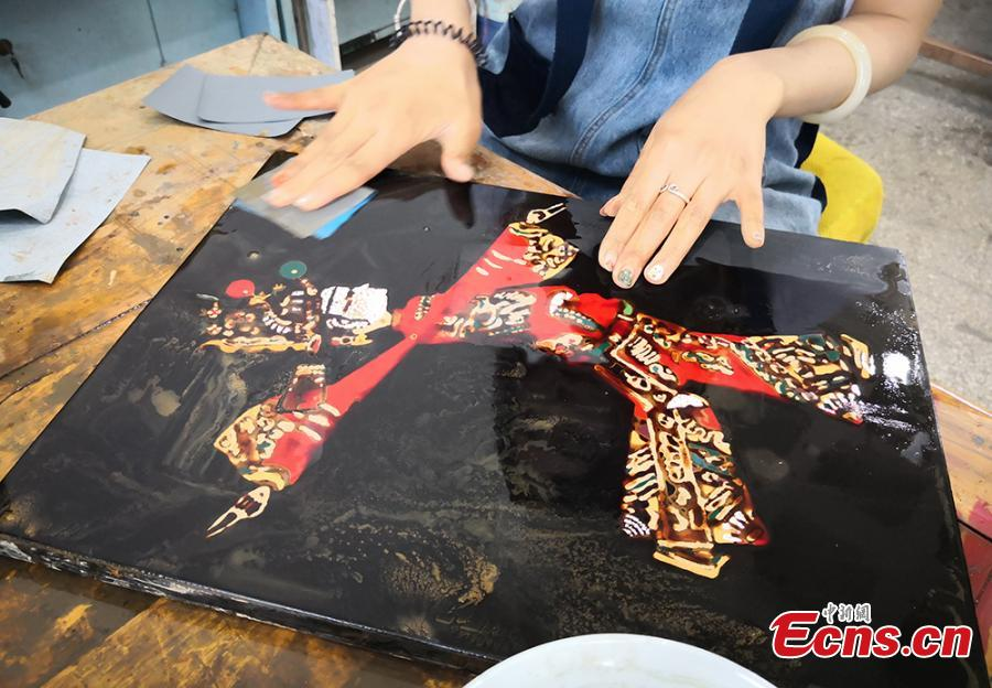Students and teachers use traditional methods to make lacquerware at the Lanzhou Polytechnic College in Lanzhou City, Northwest China's Gansu Province. The process of decorating a cup with layers of lacquer usually takes 20 days. Lacquerware refers to a variety of traditional crafts that have lacquer as their surface layer, sometimes with the addition of gold or silver sheets, eggshell, or other materials. (Photo: China News Service/Liu Yutao)