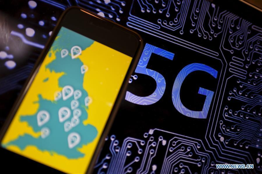 Photo taken on May 30, 2019 shows the logo of 5G network in London, Britain. Mobile network operator EE said on last Wednesday that it would launch Britain\'s first 5G service in six major cities on May 30th. (Xinhua/Han Yan)