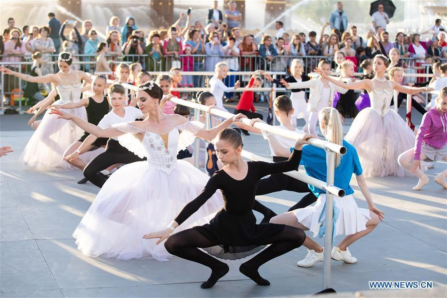 Dancers take part in a ballet master class by Nicolay Tsiskaridze during the World Ballet Holidays Festival in Moscow, Russia, on June 1, 2019. The World Ballet Holidays Festival is held from May 31 to June 2 at VDNH exhibition complex in Moscow. One of the highlights of the festival is an outdoor ballet class conducted by ballet dancer Nikolay Tsiskaridze. (Xinhua/Maxim Chernavsky)