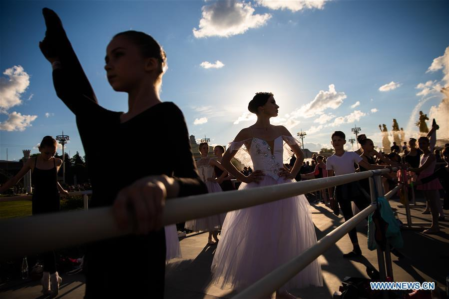 Ballet dancers get ready for a ballet master class by Nicolay Tsiskaridze during the World Ballet Holidays Festival in Moscow, Russia, on June 1, 2019. The World Ballet Holidays Festival is held from May 31 to June 2 at VDNH exhibition complex in Moscow. One of the highlights of the festival is an outdoor ballet class conducted by ballet dancer Nikolay Tsiskaridze. (Xinhua/Maxim Chernavsky)