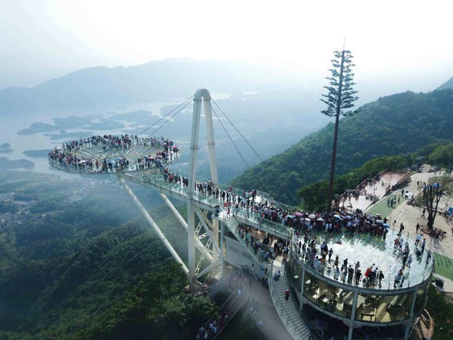 Tourists walk on the \